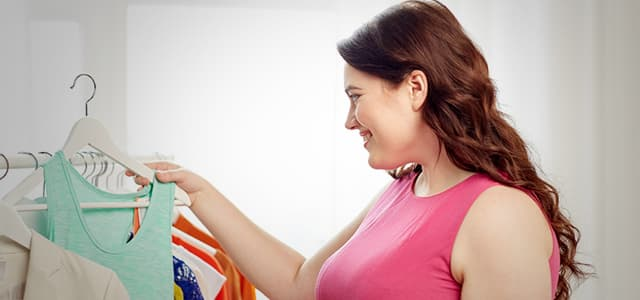 happy plus sized woman buying clothes