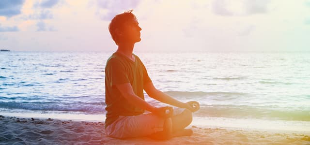 recovery-shutter238209478-guy-meditating-on-beach