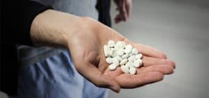recovery-shutter417001846-man-holding-white-pills