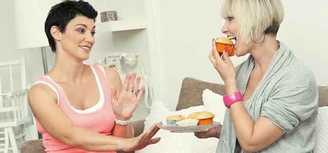 recovery-shutter98834090-woman-offering-friend-cake
