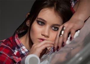 young-girl-battling-addiction-pills-on-table